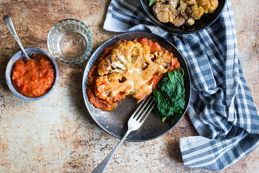 Cauliflower steaks with red pepper sauce