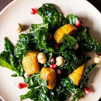 Hearty Kale Salad with Kabocha Squash, Pomegranate Seeds, and Toasted Hazelnuts