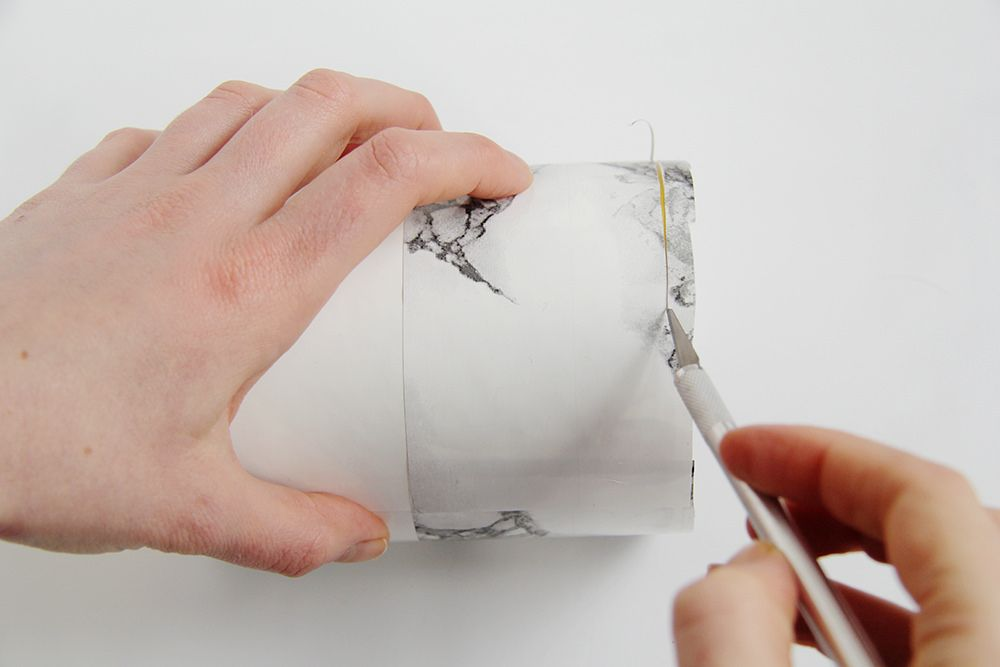 Cut off excess contact paper with a craft knife