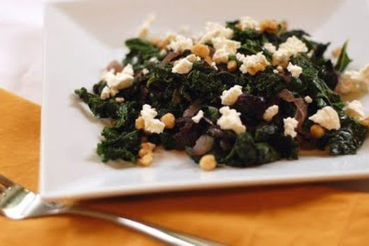 Sauteed greens w/caramelized onions, prunes & goat cheese