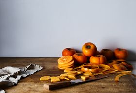 1e7672c8 2400 4baf 80d2 f43c52a7bf40  2017 0629 chopping fruit persimmon stock image rocky luten 052