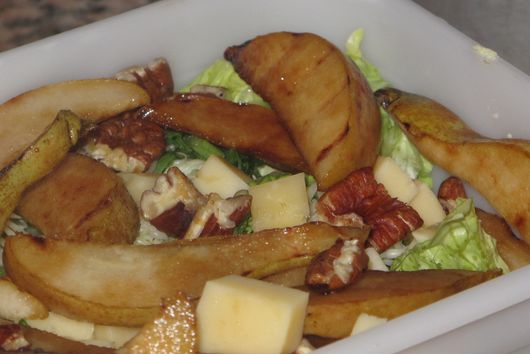 Pangrilled pear salad with pecans and maple dressing