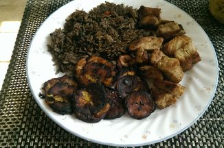 Haitian Griot And Djondjon Rice With Fried Plaintains And