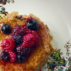 Cranberry cinnamon baked oatmeal topped with warm berries and honey