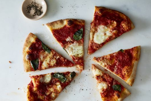 The Best Way to Reheat Pizza at Home, According to the Pros