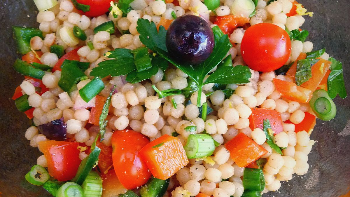 Pearl Couscous Salad With Tomatoes Peppers Mint And Cilantro Recipe On Food52