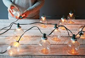 264b826c ea34 49a7 ba49 41bf27df62dd  2013 1121 small home martinellis juice jar string lamps mid 009 1
