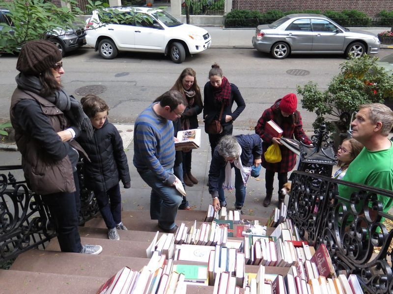 Food52ers perusing the offerings at Amanda Hesser's cookbook stoop sale.