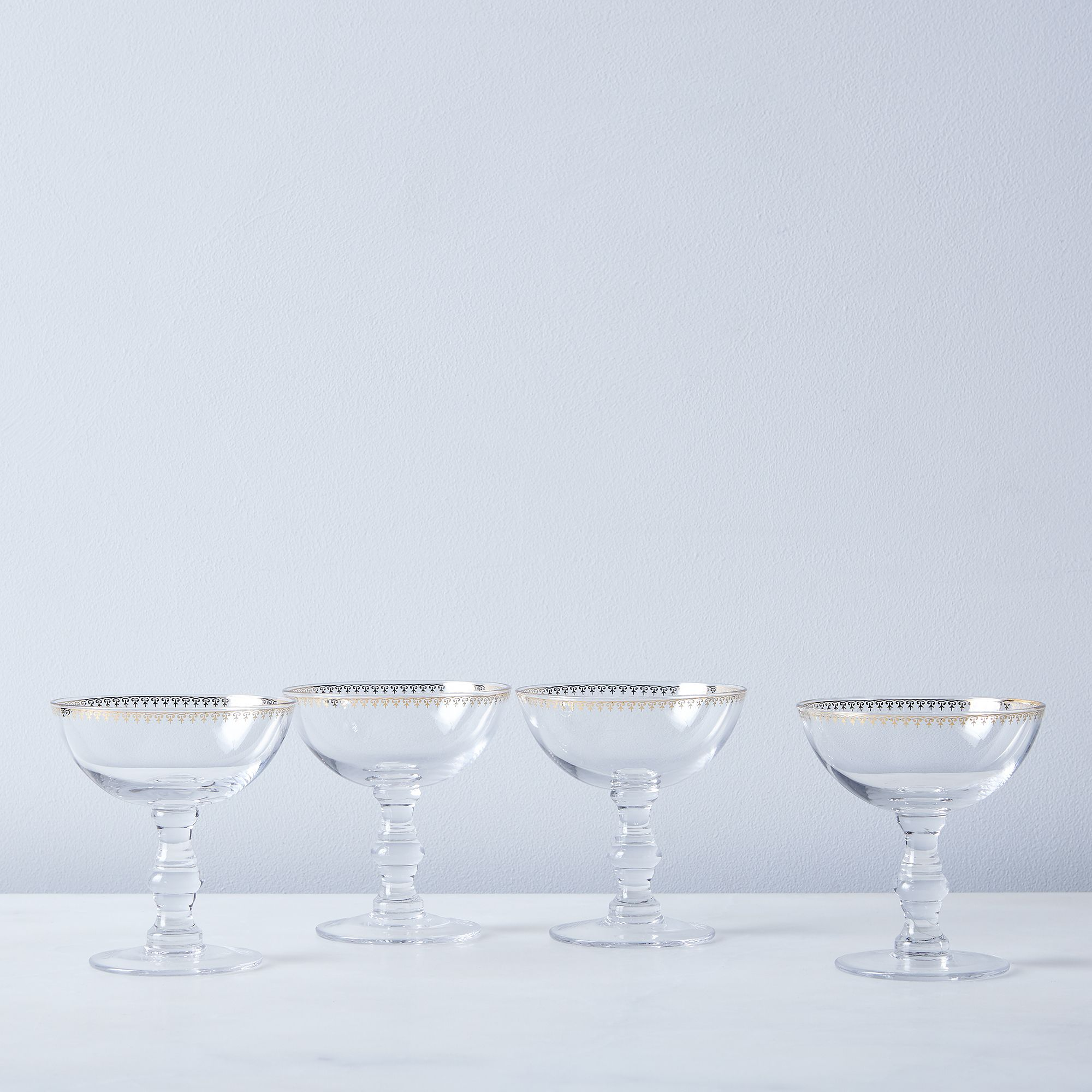 Fc4e8820 26e3 49e7 8397 e83779f6a0ed  2016 1028 kiss that frog patterned gold rimmed champagne coupes set of 4 silo rocky luten 007