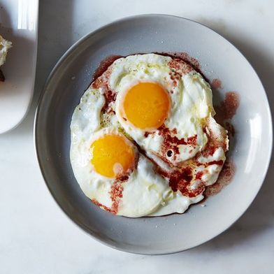 Why You Should Put Vinegar On Your Eggs