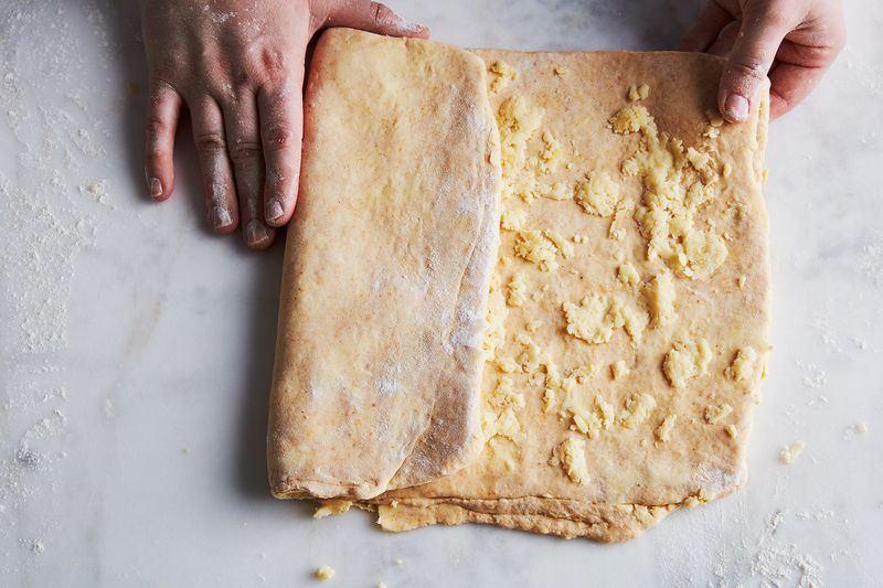Fold this dough like it's a paper going into an envelope.