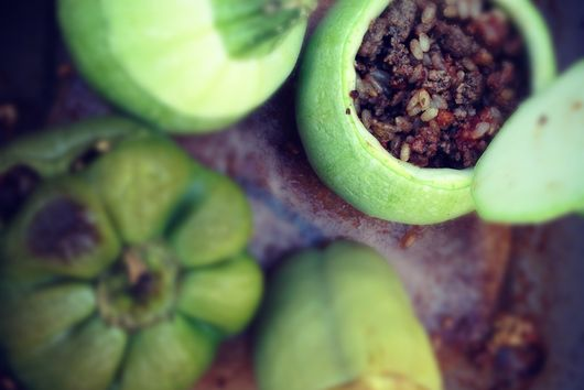 Green peppers and summer squash stuffed with ground beef, rice and spices