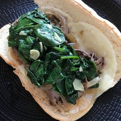 Philly Style Shredded Beef Sandwiches with Sautéed Spinach and Provolone