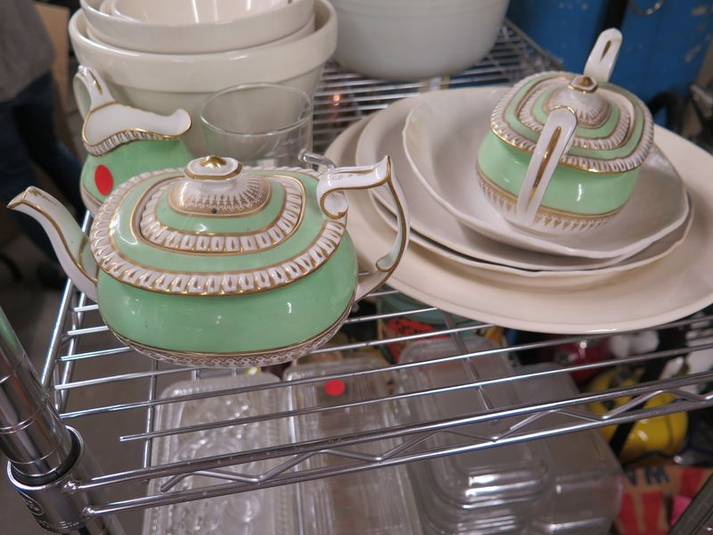 This minty green cream, sugar, and teapot would have been used on a show like Sweet Dreams with Gale Gand.