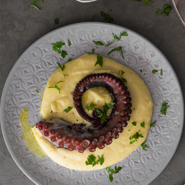 Baked octopus with creamy polenta