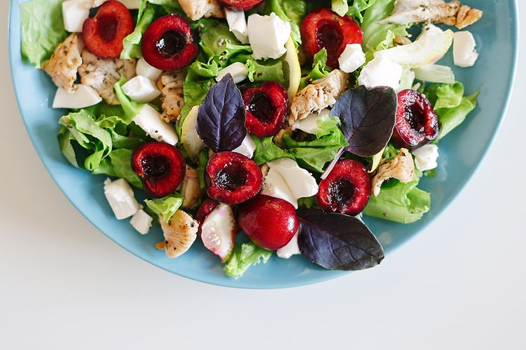 Summer salad with sweet cherry and grilled turkey