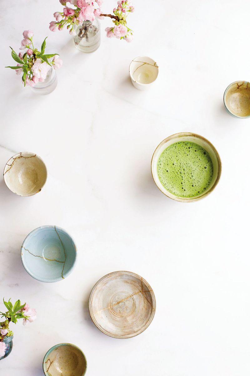 Teacups repaired through the art of kintsugi.