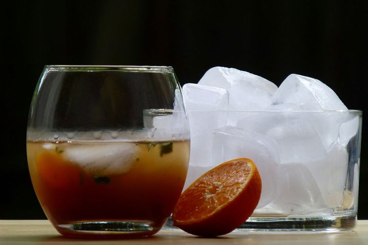 Dark orange gin on the rocks
