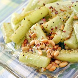 Brown butter braised cucumbers with pine nuts and coarse salt