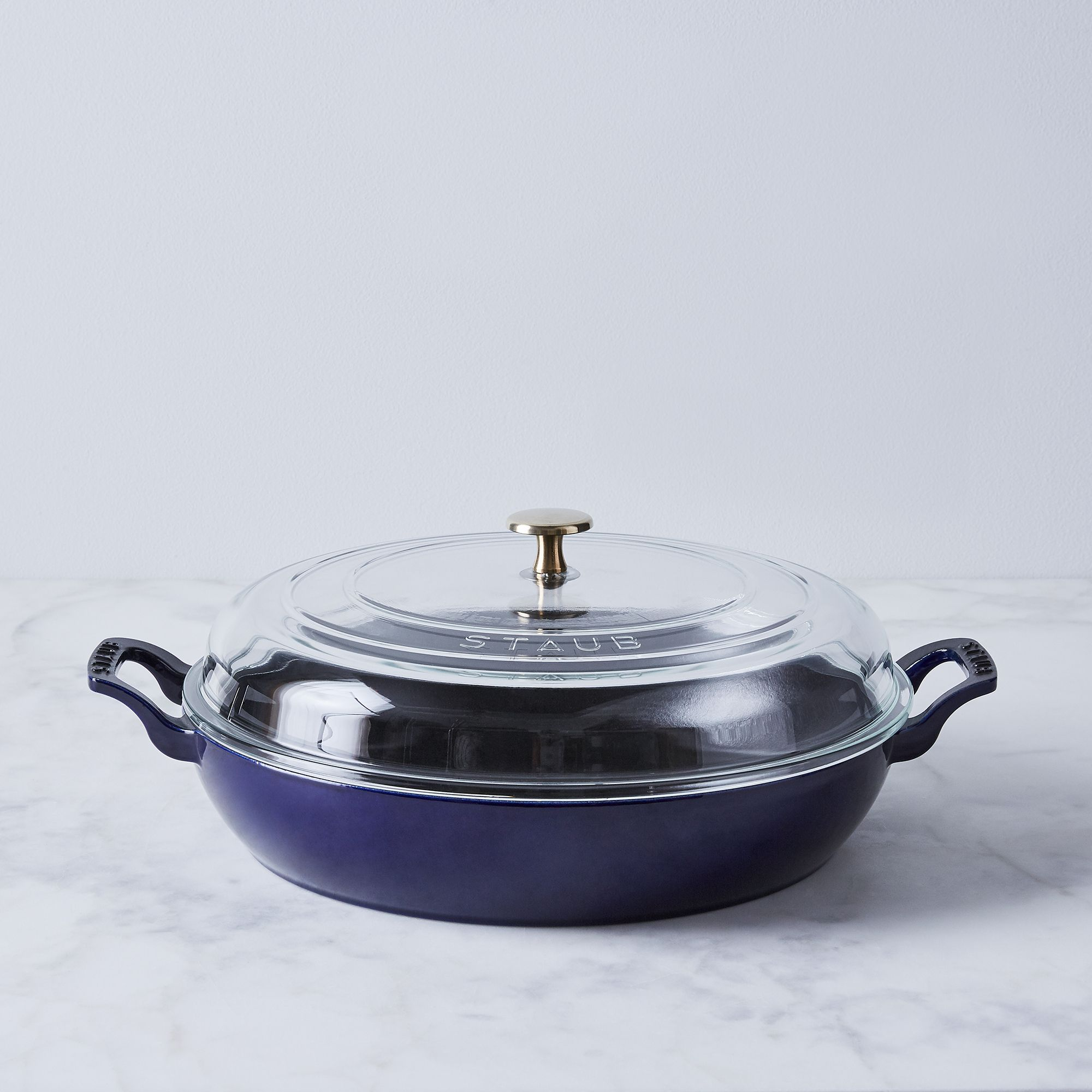 49cbfbf6 b595 4e11 9ec3 7f3e69173cb3  2018 0109 staub food52 x staub multi use braiser w glass lid 3.5qt blue with brass silo bobbi lin 6108
