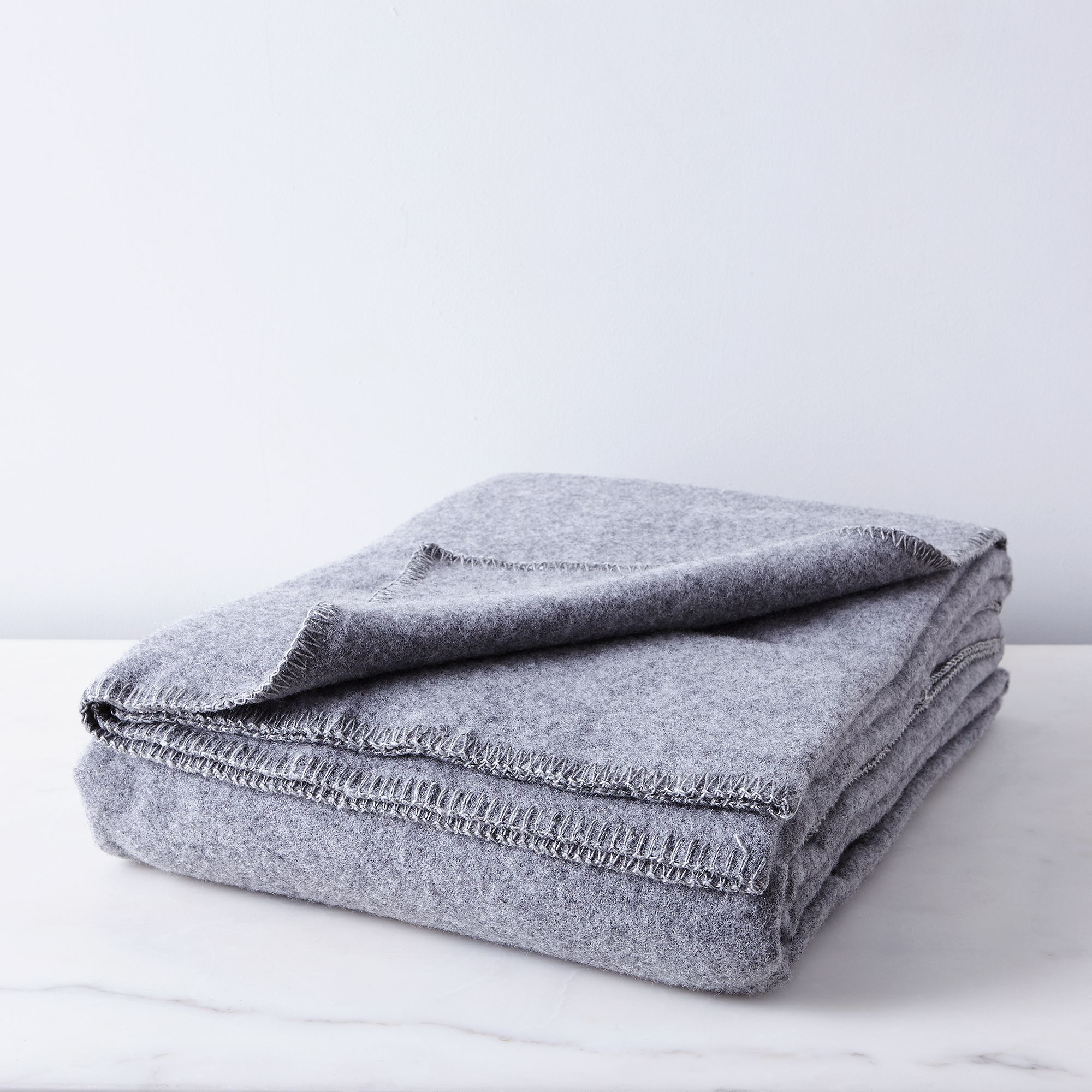 9faab718 63cd 4c42 8289 96be52d84f43  2016 1025 faribault pure and simple wool whipstitch edged blanket heather grey silo rocky luten 003