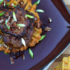 Spicy Mapled Pork Medallions over Jalapeño & Grits Waffles