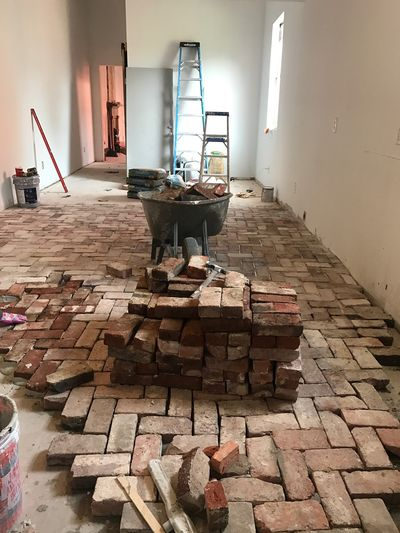 Laying the new (old brick) floors.