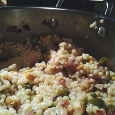 Warm Couscous Salad w/ Olives + Pine Nuts