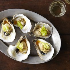 Kristen Kish's Oysters with Caramelized Honey, Tomato Broth, Celery Leaves, and Chili