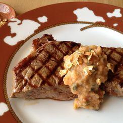 Persimmon Caper Seasoned Butter Dressing a Steak