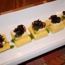 Polenta Cakes with Caramelized Onions, Brie and Basil Oil