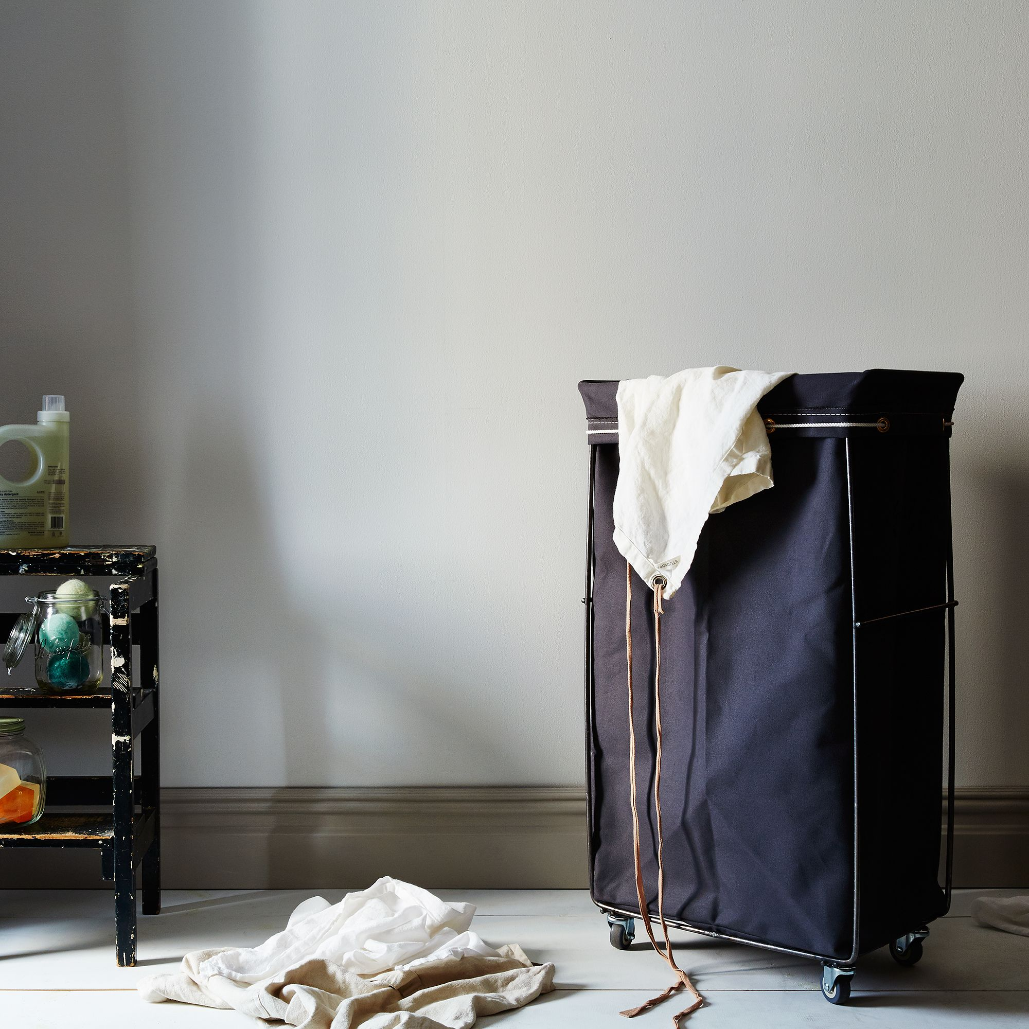 Grey narrow elevated laundry basket on food52