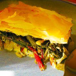 Harvest pie with swiss chard, cheese, orange zest and fennel
