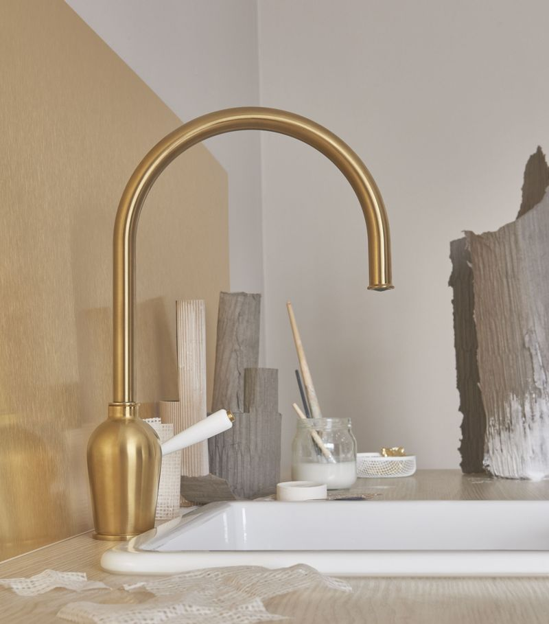 A brass faucet instantly makes a sink more chic.