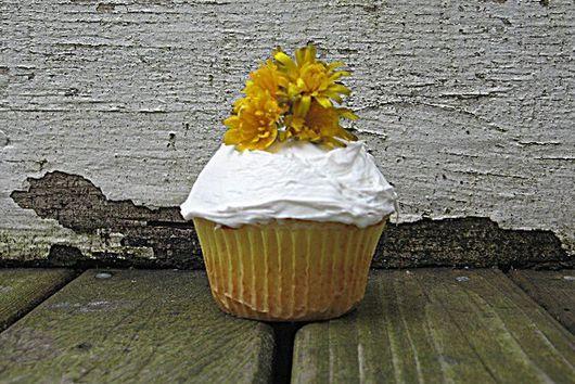 Lemon Poppy Seed Cupcakes Topped With Lemon Buttercream Frosting
