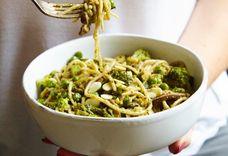 Brown rice pasta with broccoli, pesto, toasted almonds and peas