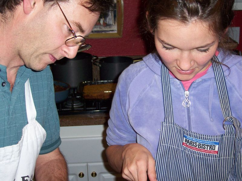 My dad and I figuring out how to debone birds, 2005. (Hey, you were wearing purple track suits then, too.)