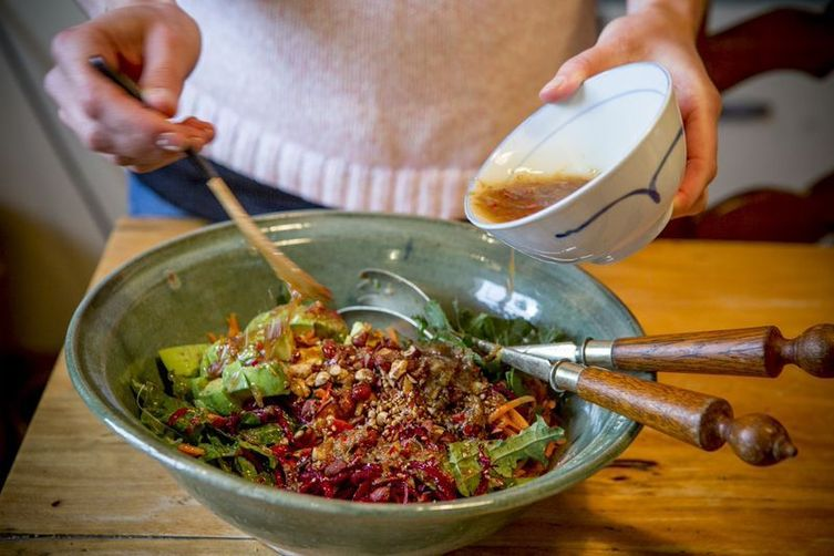 Kale salad with beetroot, carrot, avocado with toasted nuts and asian dressing