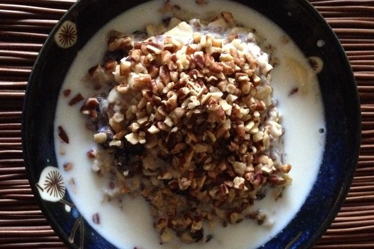 Raisin, pecan, and banana oatmeal with flax seeds