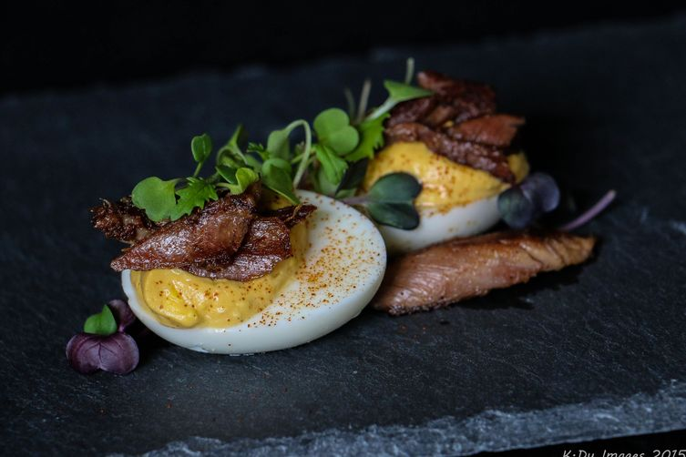 Chipotle and Duck Confit Deviled Eggs with Microgreens