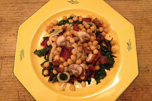 Chickpeas with bacon, portabellos and leeks over lemony swiss chard