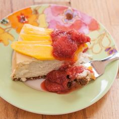 Cheesecake with Toasted Coconut Crust, Sliced Mango and Strawberry-Rhubarb Sauce