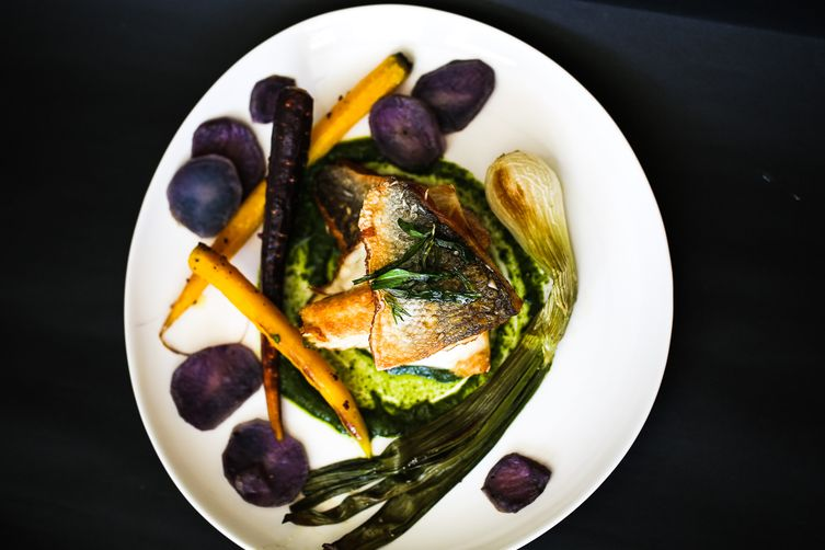 Pan-Fried Branzino with whole roasted scallions and purple potatoes