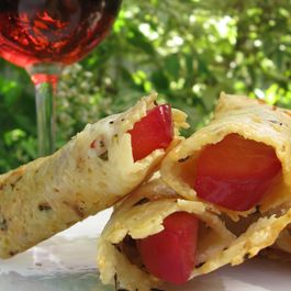 Parmesan Rosemary Tuille with Rosé-Poached Plums