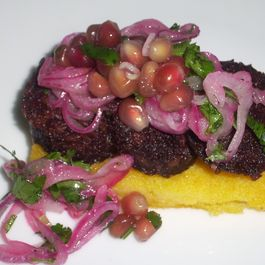 Polenta, black pudding and red onion pomegranate salad