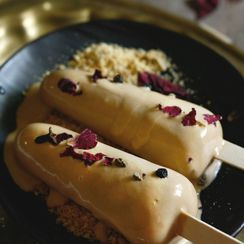 Masala chai popsicle with bourbon chocolate sauce and butter biscuit crumble