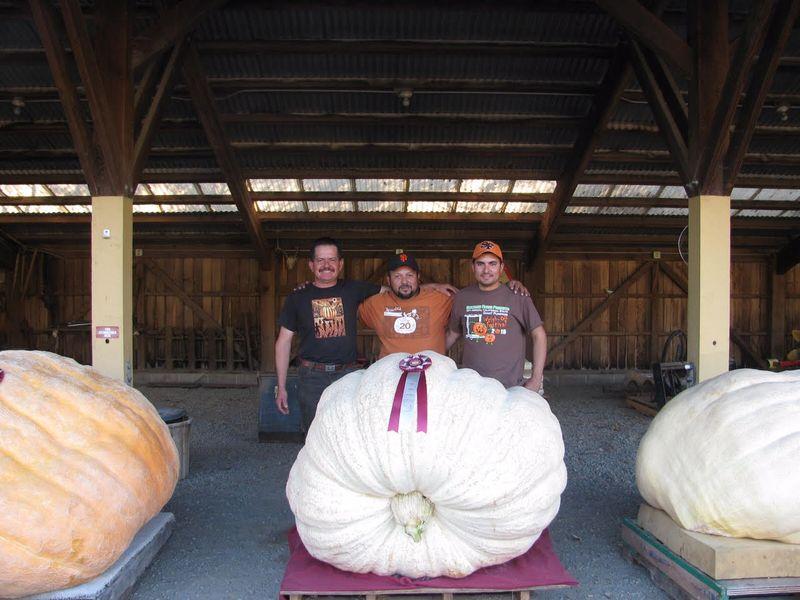 Leonardo, far left, posing with his prize pumpkin. Photo courtesy of Hudson Ranch.