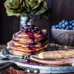 FARRO & RICOTTA PANCAKES WITH BLUEBERRY COMPOTE & BERGAMOT LEMON SYRUP