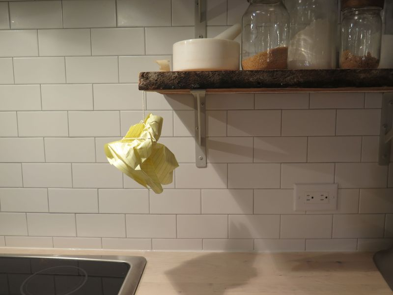 You can also create origami by crushing a paper into an organic shape, then hang it up with thread and tape.