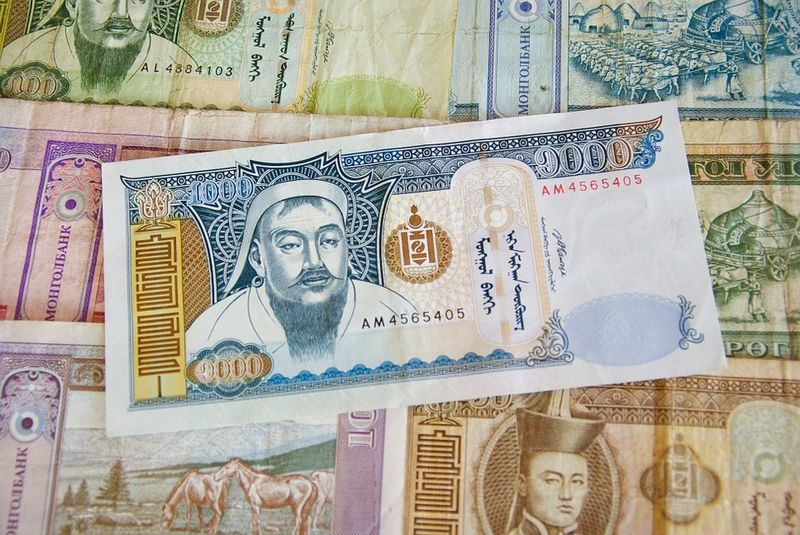 A Mongolian banknote with Genghis Khan.